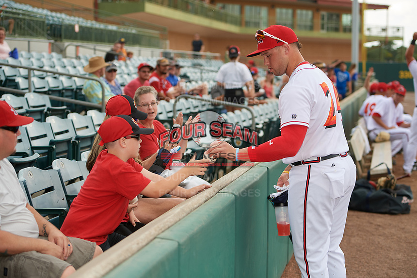 Florida Fire Frogs first baseman Braxton Davidson (24) signs autographs for fans during a game against the Daytona Tortugas on April 7, 2018 at Osceola County Stadium in Kissimmee, Florida.  Daytona defeated Florida 4-3.  (Mike Janes/Four Seam Images)