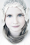 Female youth looking at camera with blue eyes wearing a lace veil over her head