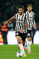 Calcio, Serie A: Napoli vs Juventus. Napoli, stadio San Paolo, 30 marzo 2014. <br /> Juventus forward Mirko Vucinic, of Montenegro, in action during the Italian Serie A football match between Napoli and Juventus at Naples' San Paolo stadium, 30 March 2014.<br /> UPDATE IMAGES PRESS/Isabella Bonotto