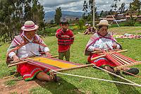 Peru, Urubamba Valley, Quechua Village of Misminay.  Women Weaving.