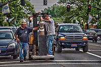 Workers transport one of a series of art pieces installed in Westerville, Ohio as part of a year long public display of art.