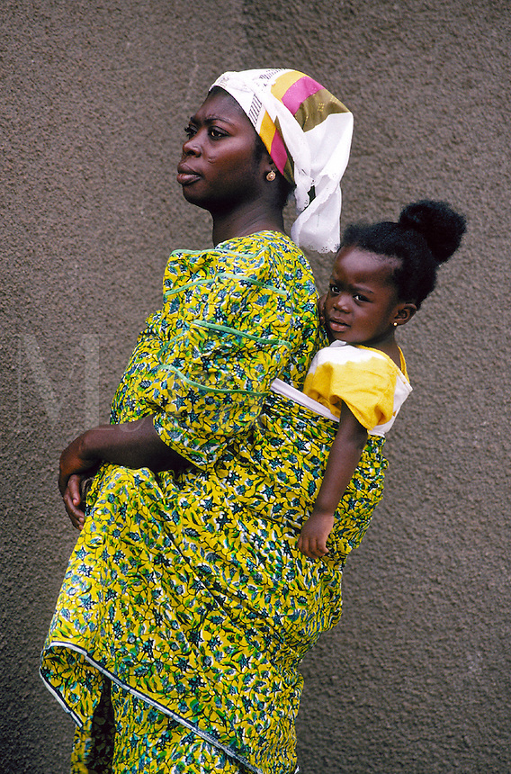 African mother and young child in traditional, colorful dress in Ghana, Africa. mom & child. Ghana Africa.