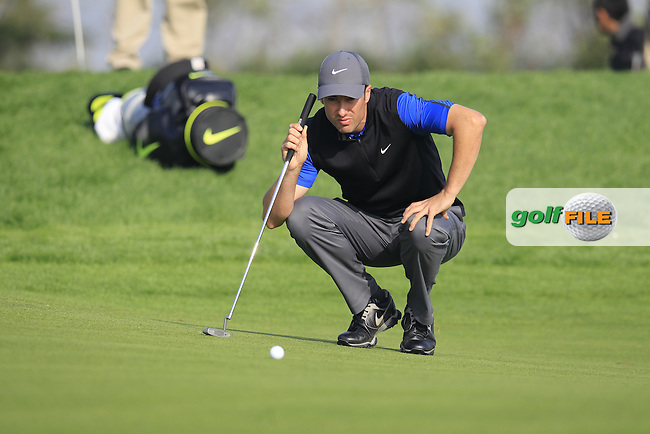 Ross Fisher (ENG) lines up his putt on the 16th green during Sunday's Final Round of the 2014 BMW Masters held at Lake Malaren, Shanghai, China. 2nd November 2014.<br /> Picture: Eoin Clarke www.golffile.ie