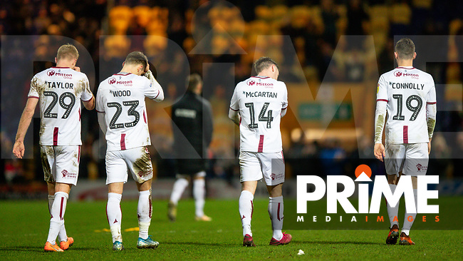 Chris Taylor, Connor Wood, Shay McCartan and Dylan Connolly all leave the field with their heads down after Bradford Citys 3-0 defeat during the Sky Bet League 2 match between Mansfield Town and Bradford City at the One Call Stadium, Mansfield, England on 25 January 2020. Photo by Thomas Gadd.