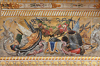 Frieze with armour, weapons, satyr heads and a frit garland at the top of the walls of the Guard Room, attributed to Ruggerio de Ruggieri, c. 1570, rearanged in Louis XIII's day, Chateau de Fontainebleau, France. The Palace of Fontainebleau is one of the largest French royal palaces and was begun in the early 16th century for Francois I. It was listed as a UNESCO World Heritage Site in 1981. Picture by Manuel Cohen