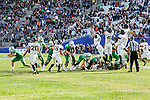 North Texas Mean Green kick an extra point during the Zaxby's Heart of Dallas Bowl game between the Army Black Knights and the North Texas Mean Green at the Cotton Bowl Stadium in Dallas, Texas.