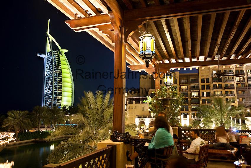 United Arab Emirates, Dubai: Bar in the Mina A'Salam hotel with view of the Burj al Arab at night