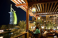 United Arab Emirates, Dubai: Bar in the Mina A'Salam hotel with view of the Burj al Arab at night