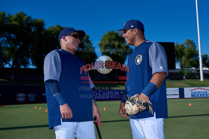 AZL Brewers Gold teammates Roberto Molina (57) and Juan Martinez (20) laugh before an Arizona League game against the AZL Brewers Blue on July 13, 2019 at American Family Fields of Phoenix in Phoenix, Arizona. The AZL Brewers Blue defeated the AZL Brewers Gold 6-0. (Zachary Lucy/Four Seam Images)