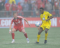 Carl Robinson (33) and Emmanuel Ekpo (17) in action at  BMO Field on Saturday September 13, 2008. .The game ended in a 1-1 draw.