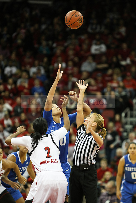 Kentucky forward Azia Bishop and Louisville forward Myisha Hines-Allen compete for the tip off during the first half of the Kentucky vs. Louisville women's basketball game at the KFC Yum! Center on Sunday, December 7, 2014 in Lexington, Ky. Louisville leads Kentucky 42-29 at halftime. Photo by Adam Pennavaria | Staff