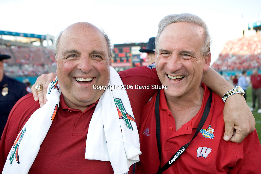 ORLANDO, FL - JANUARY 2:  Head coach Barry Alvarez, left, of the Wisconsin Badgers walks off the field with friend Ted Kellner after the game against the Auburn Tigers on January 2, 2006 at the Capital One Bowl in Orlando, Florida. The Badgers beat the Tigers 24-10. (Photo by David Stluka)