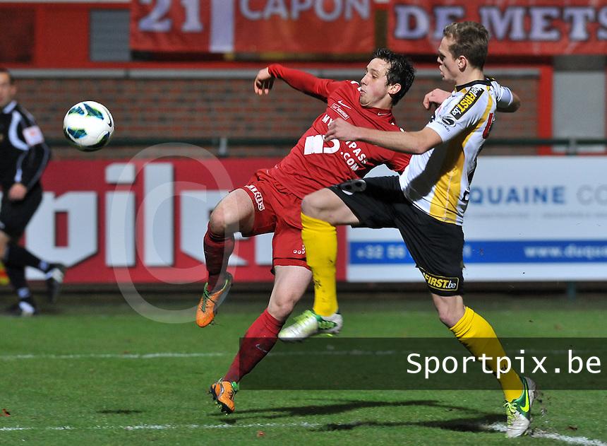 KV Kortrijk - Sporting Lokeren : duel om de bal tussen Brecht Dejaegere en Laurens De Bock.foto VDB / BART VANDENBROUCKE