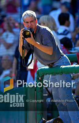 23 September 2007: Washington Nationals team photographer Mitchell Layton takes photos at the very last professional baseball game played at Robert F. Kennedy Memorial Stadium in Washington, DC. The Nationals defeated the visiting Philadelphia Phillies 5-3 to close out the 2007 home season. The Nationals will open up the 2008 season at Nationals Park, their new facility currently under construction.. .Mandatory Photo Credit: Ed Wolfstein Photo