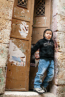 A young boy stands in a doorway in the Moslem Quarter of the Old City in Jerusalem near the Temple Mount.