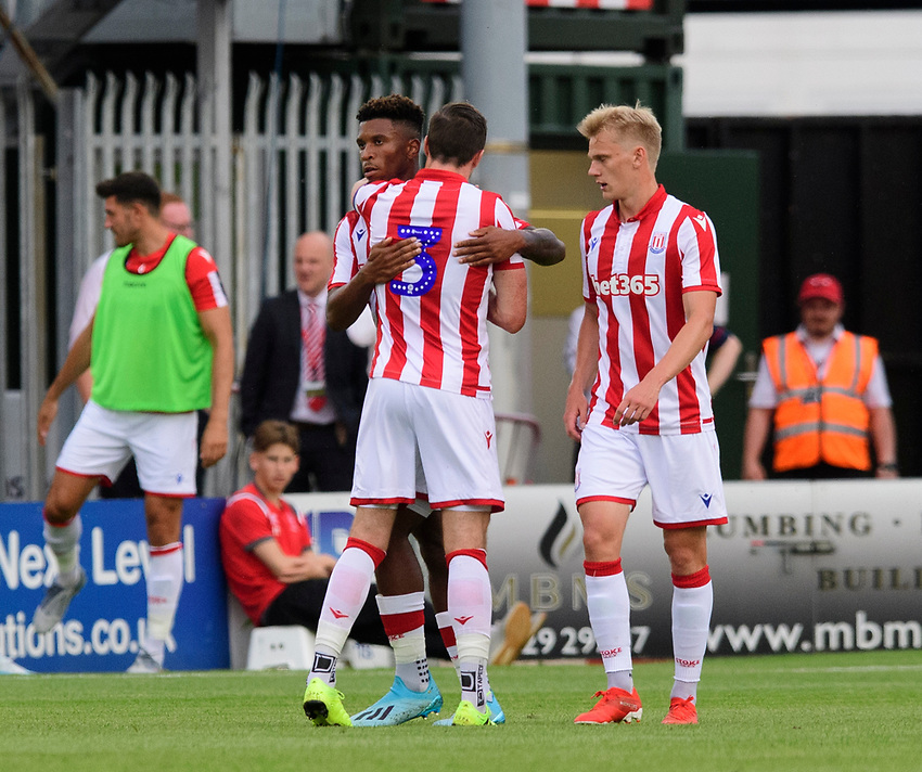 Stoke City's Tyrese Campbell, centre, celebrates scoring his side's second goal with team-mate Stephen Ward<br /> <br /> Photographer Chris Vaughan/CameraSport<br /> <br /> Football Pre-Season Friendly - Lincoln City v Stoke City - Wednesday July 24th 2019 - Sincil Bank - Lincoln<br /> <br /> World Copyright © 2019 CameraSport. All rights reserved. 43 Linden Ave. Countesthorpe. Leicester. England. LE8 5PG - Tel: +44 (0) 116 277 4147 - admin@camerasport.com - www.camerasport.com