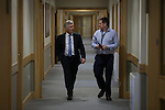 © Joel Goodman - 07973 332324 . 29/05/2015 . Leigh , UK . Tony Lloyd with his PR as Police and Crime Commissioner , Smyth Harper , in a corridor at Leigh Sports Village . Lloyd has been selected as interim Mayor of Greater Manchester in what is the UK's first devolved Mayorilty with such power , outside of London . Photo credit : Joel Goodman