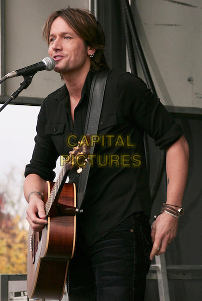 KEITH URBAN.performs a free acoustic set at the Verizon Wireless Store, Cool Springs, Tennessee, USA, .30th October 2009..music concert gig live on stage performing half length guitar microphone black top shirt singing                   .CAP/ADM/EM.©Eddie Malone/Admedia/Capital Pictures
