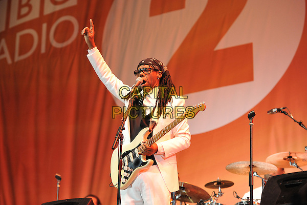 CHIC - Nile Rodgers.Performing live at BBC Radio 2 Live in Hyde Park, London, England..September 11th, 2011.stage concert live gig performance music half length black bandana white suit guitar glasses arm in air.CAP/MAR.© Martin Harris/Capital Pictures.