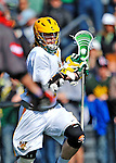 17 March 2012: University of Vermont Catamount Attackman A.J. Masson, a Junior from Newmarket, Ontario, in action against the Sacred Heart University Pioneers at Virtue Field in Burlington, Vermont. The visiting Pioneers rallied to tie the score at 11 with five unanswered goals in the 4th period. However the Cats came back with only 10 seconds remaining in the game to defeat the Pioneers 12-11 in their non-conference matchup. Mandatory Credit: Ed Wolfstein Photo