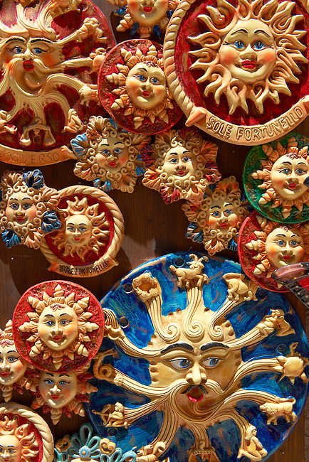 Pottery suns and  Trinacria in tourist shops and Sicilian pottery Érice, Erice, Sicily stock photos.