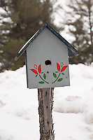 Detail of a birdhouse at the Keweenaw Mountain Lodge in Copper Harbor Michigan in winter.
