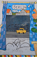 Section of the Berlin Wall depicting a detail from the painting Mauern International by Alexej Taranin with a yellow Trabant car driving alongside the Berlin Wall, damaged by graffiti, part of the East Side Gallery, a 1.3km long section of the Wall on Muhlenstrasse painted in 1990 on its Eastern side by 105 artists from around the world, Berlin, Germany. Picture by Manuel Cohen