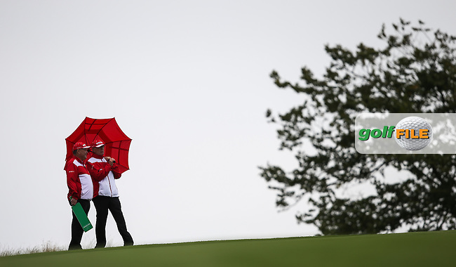 Marshals expecting rain during the Made in Denmark 2014 Pro-Am from the Himmerland Golf & Spa Resort, Aalborg, Denmark. Picture:  David Lloyd / www.golffile.ie