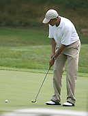 Martha's Vineyard, MA - August 25, 2009 -- United States President Barack Obama putts during a round of golf at Mink Meadows GC, Vineyard Heaven, Massachusetts on Tuesday, August 25, 2009..Credit: Michael J. Maloney - Pool via CNP