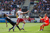 Kenny Cooper (33) of the New York Red Bulls gets past Carlos Valdes (2) of the Philadelphia Union and beats goalkeeper Zac MacMath (18) to score the game winning goal/ The New York Red Bulls defeated the Philadelphia Union  3-2 during a Major League Soccer (MLS) match at PPL Park in Chester, PA, on May 13, 2012.