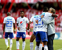 CALI - COLOMBIA, 12- 05-2019: Fabián González, de Millonarios, celebra con Jorge Luis Pinto gol anotado a América de Cali, durante partido entre América de Cali y Millonarios, de la fecha 1 de los cuadrangulares semifinales por la Liga Águila I 2019 jugado en el estadio Pascual Guerrero de la ciudad de Cali. / Fabian Gonzalez of Millonarios, celebrates with Jorge Luis Pinto a scored goal to America de Cali, during a match between America de Cali and Millonarios, of the 1st date of the semifinals quarters for the Aguila Leguaje I 2019 at the Pascual Guerrero stadium in Cali city. Photo: VizzorImage / Nelson Ríos / Cont.