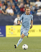 Sporting Kansas City defender Michael Harrington (2) brings the ball forward. In a Major League Soccer (MLS) match, Sporting Kansas City defeated the New England Revolution, 1-0, at Gillette Stadium on August 4, 2012.