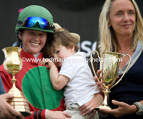Barbara Noell, one of Bon Caddo's owners, shares the Virginia Gold Cup stage with jockey Blair Wyatt and son, James.