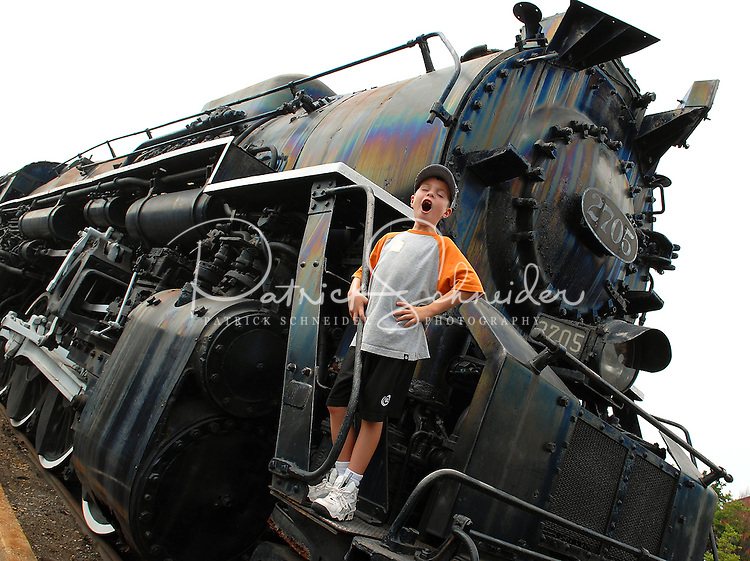 A young boy calls riders aboard an engine at the North Carolina Transportation Museum, located just outside Charlotte, NC, in Spencer, NC.