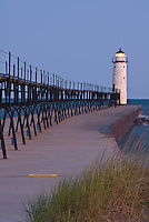 The Manistee Pierhead light sits on the Lake Michigan shore in pre-dawn light, Manistee, Manistee County, Michigan