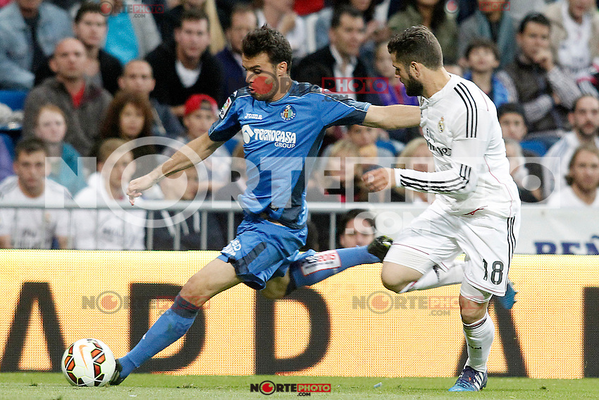 Real Madrid's Nacho Fernandez (r) and Getafe's Pedro Leon during La Liga match. May 23,2015. (ALTERPHOTOS/Acero) /NortePhoto.com