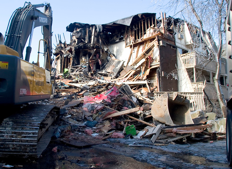 WATERBURY, CT- 12 FEB 06- 021207JT01- <br /> A fire Sunday morning left parts of the Bradley Gardens apartment complex in ruins on Monday. <br /> Josalee Thrift Republican-American