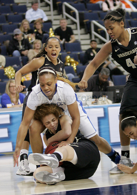 UK guard Bernisha Pinkett gets on top of Vanderbilt guard Jasmine Jenkins during a scramble during the first half of the University of Kentucky women's basketball game vs. Vanderbilt University during the SEC tournament The Arena at Gwinnett Center in Duluth, Ga. on Friday, March 8, 2013. UK won 76-65. Photo by Genevieve Adams | Staff
