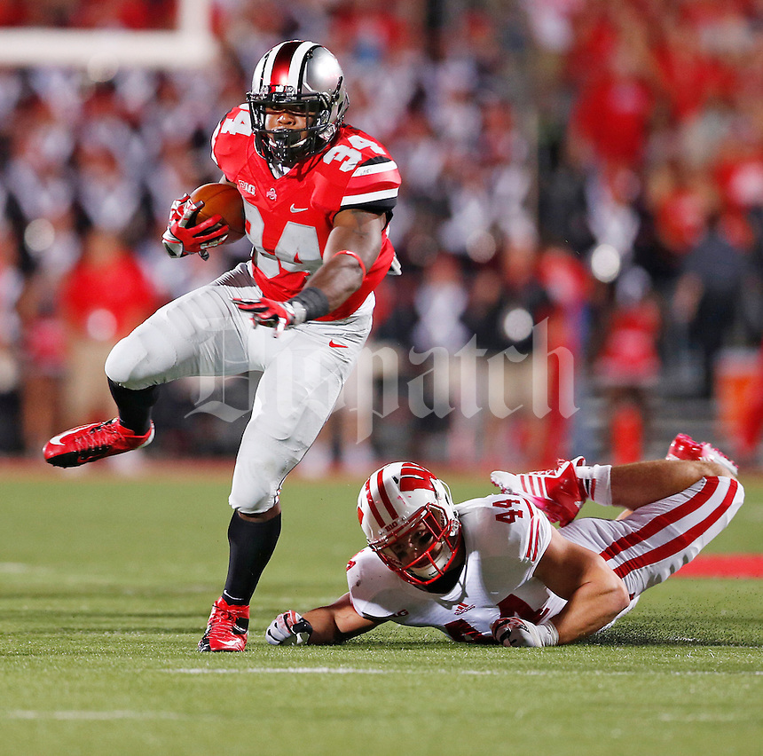 Ohio State Buckeyes running back Carlos Hyde (34) gets by Wisconsin Badgers linebacker Chris Borland (44) for a gain in the first half at Ohio Stadium on September 28, 2013.  (Chris Russell/Dispatch Photo)