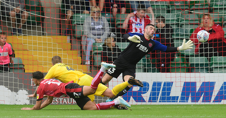 Lincoln City's Tyler Walker scores the opening goal, sending a diving header past Fleetwood Town's Matt Gilks<br /> <br /> Photographer Chris Vaughan/CameraSport<br /> <br /> The EFL Sky Bet League One - Lincoln City v Fleetwood Town - Saturday 31st August 2019 - Sincil Bank - Lincoln<br /> <br /> World Copyright © 2019 CameraSport. All rights reserved. 43 Linden Ave. Countesthorpe. Leicester. England. LE8 5PG - Tel: +44 (0) 116 277 4147 - admin@camerasport.com - www.camerasport.com