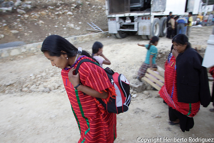 A Triqui Native woman walks past a trailer in the Yosoyuxi village, in the Triqui region of Oaxaca, November 18, 2005. The political violence has been increased by the paramilitary groups like UBISORT in the Triqui region, where they ambushed an humanitarian caravan and killing two people on APril 27, 2010.  Photo by Heriberto Rodriguez