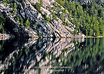 Quartzite Ledges Reflecting in George Lake at Killarney Provincial Park, Ontario
