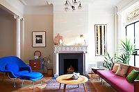 Boldly coloured furniture brings warmth and another expression of the house to this sitting room