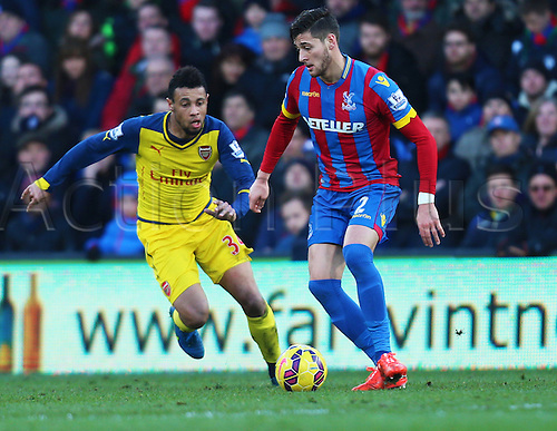 21.02.2015.  London, England. Barclays Premier League. Crystal Palace versus Arsenal. Crystal Palace defender Joel Ward moves past Arsenal midfielder Francis Coquelin