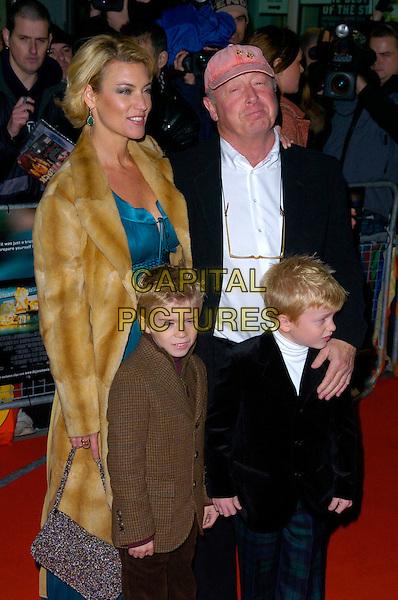 TONY SCOTT & FAMILY.Deja Vu UK film premiere, Odeon Kensington, London, UK..December 7th, 2006.half length brown fur coat kids pink baseball cap hat.CAP/CAN.©Can Nguyen/Capital Pictures