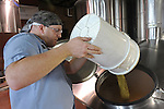 A brewer prepares fresh batches of Goose Island's signature microbrews at the main Goose Island brewery at 1800 W. Fulton in Chicago, Illinois on June 15, 2009.