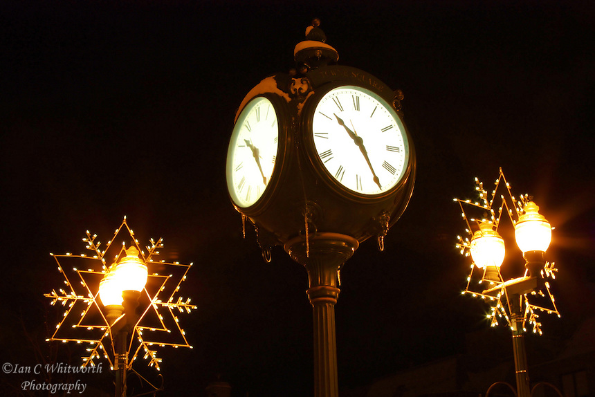 The Oakville town square clock at night during Christmas time