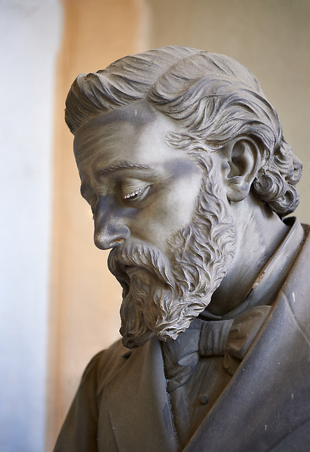 Picture and image of the stone sculpture of a mouring bearded man in the Bourgeois Realistic style. Badaracco Tomb sculpted by G Moreno 1878. Section A, no 44, The monumental tombs of the Staglieno Monumental Cemetery, Genoa, Italy