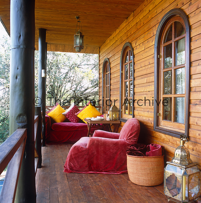 A balcony off the main bedroom is comfortably furnished to take advantage of the sunset