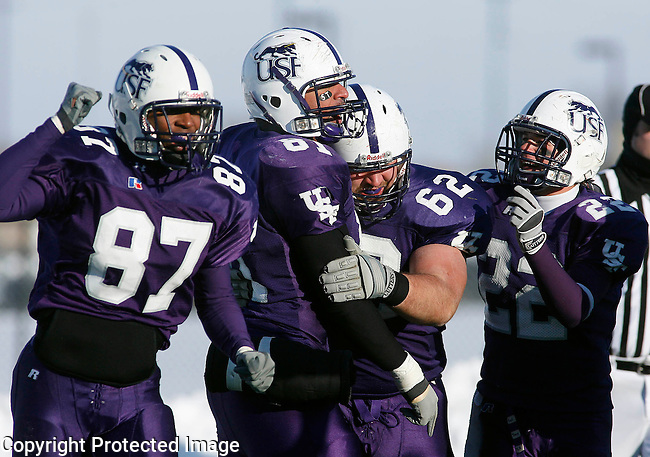 Josiah Fenceroy #81 of the University of Sioux Falls celebrates his touchdown reception with teammates Robert Kirvin #87, T.J. Wendt #62 and Erik Cimpl #22 in the final minute their NAIA football playoff game against Missouri Valley College Sunday afternoon December 2, 2007 at Bob Young Field in Sioux Falls, S.D. USF won 11-10 to advance to the national championship game in Savannah, TN December 15.